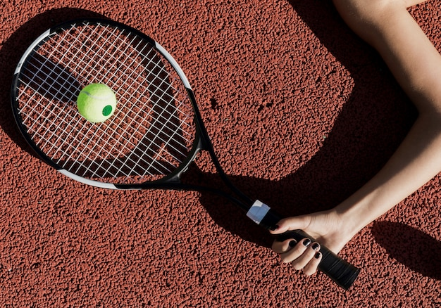 Tennis player holding racket top view Free Photo
