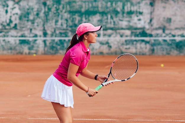 Tennis player. profile picture of concentrated woman in sportswear, playing tennis Free Photo