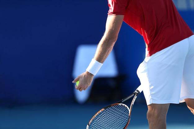 Tennis player with blue backgound Premium Photo
