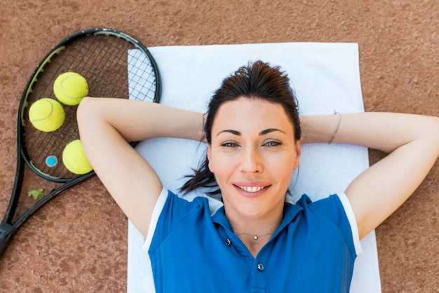 Tennis player with her racket Free Photo