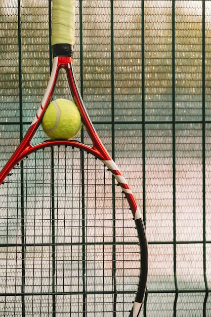 Tennis racket on a fence Free Photo