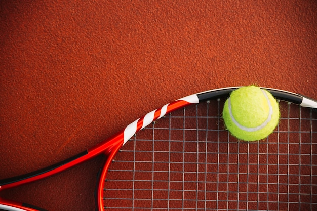 Tennis racket with a tennis ball Free Photo