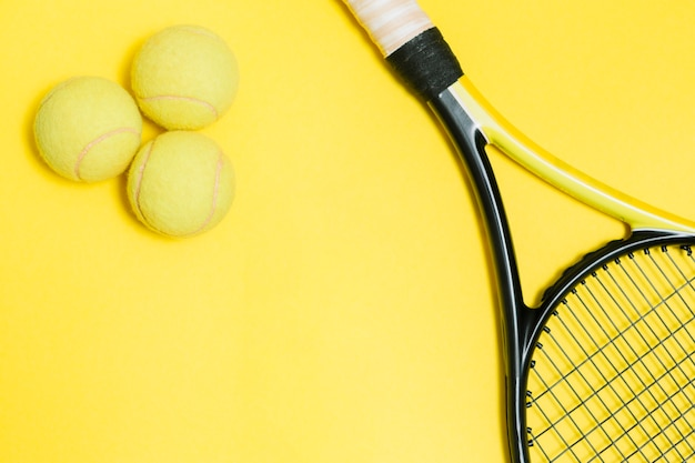 Tennis racket with yellow balls Free Photo