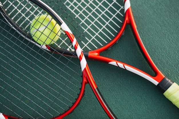 Tennis rackets on the field Free Photo