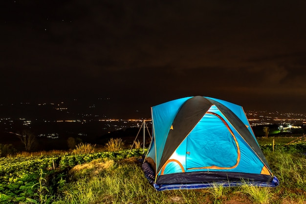 Tent and background sky and mountain views at night. Premium Photo