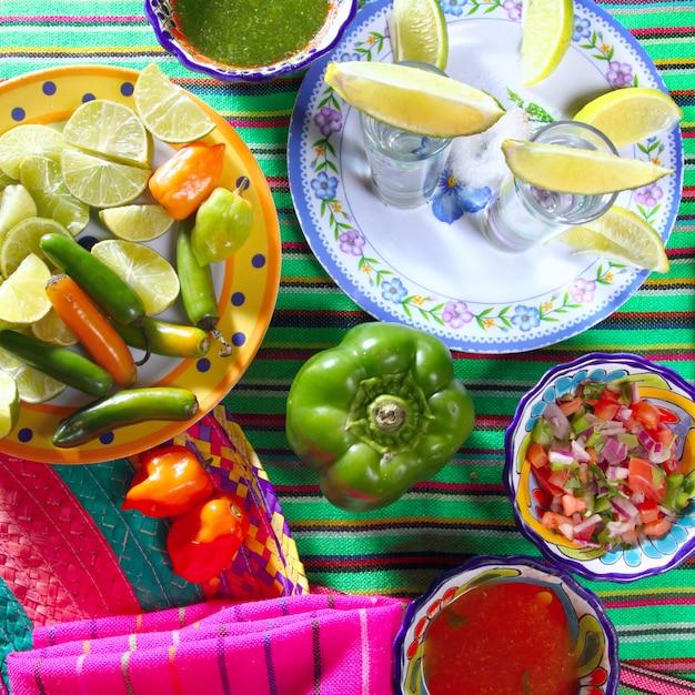 Tequila salt lemon mexican chili sauces pepper Premium Photo