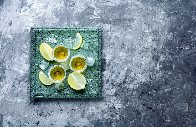 Tequila shot with lime and salt Premium Photo