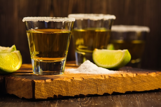 Tequila shots, salt and lime slices Premium Photo
