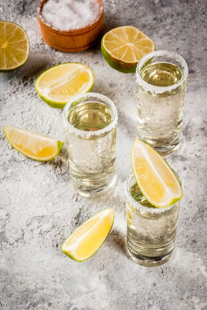 Tequila shots with lime and salt Premium Photo
