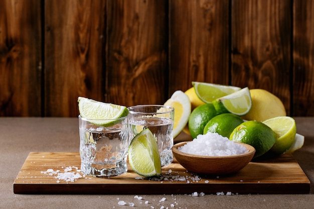 Tequila with salt and limes Premium Photo