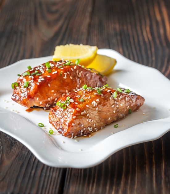 Premium Photo Teriyaki Salmon On The White Plate