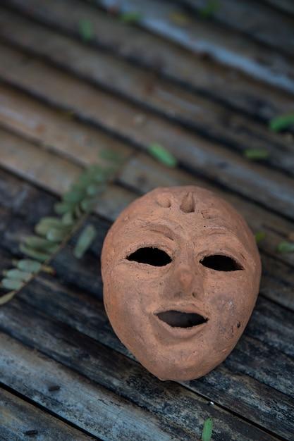 Terracotta mask Premium Photo