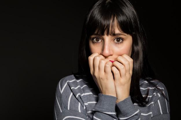 Terrified woman looking at camera Free Photo