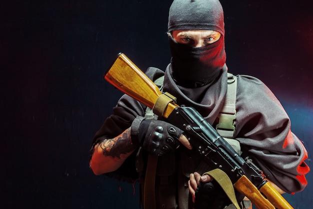 Terrorist with his weapon. concept about terrorism Premium Photo