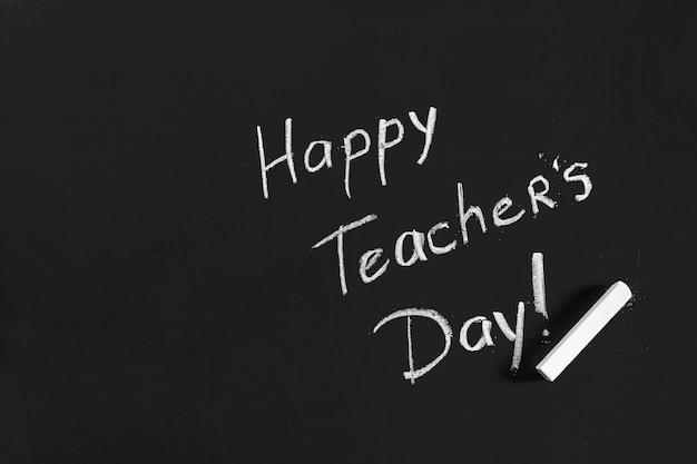 Text happy teachers day written on a chalkboard Premium Photo