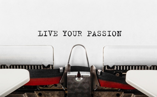 Text live your passion typed on typewriter. Premium Photo