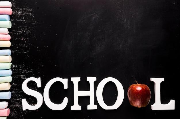 Text school and chalk on blackboard Free Photo
