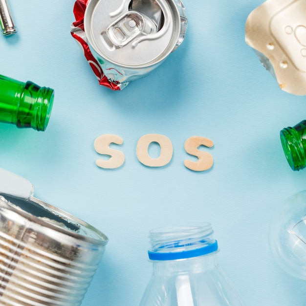 Text sos with various type of garbage Free Photo