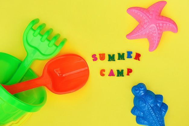 Text summer camp and multicolored set children's toys for summer games ent Premium Photo