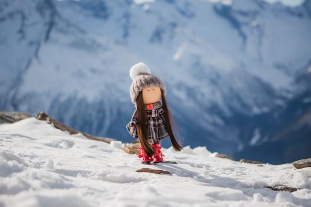 Textile handmade doll in winter clothes Premium Photo