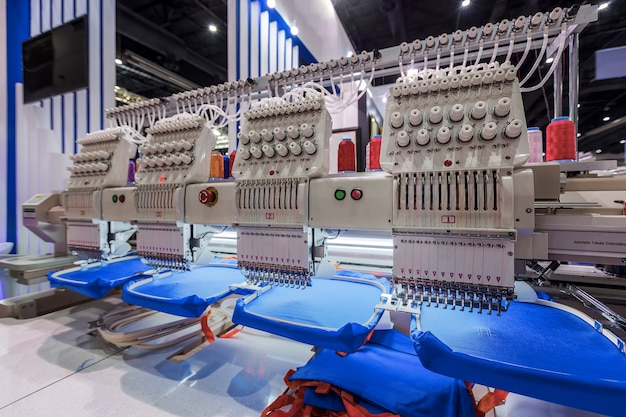 Textile professional industrial embroidery. sewing machine is used to create patterns on t Premium Photo