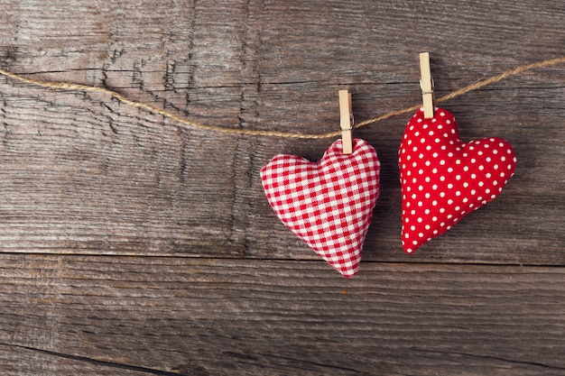 Textile valentines day hearts on wooden Free Photo