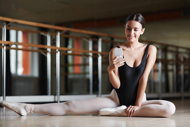 Texting during ballet class Free Photo