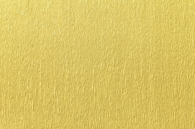 Textural of golden background of wavy corrugated paper, closeup. Premium Photo