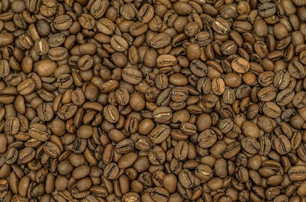 テクスチャ、コーヒー豆全体の背景 Premium写真