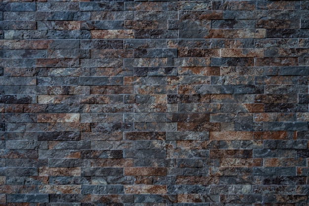 Texture of black with brown brick stone wall Free Photo