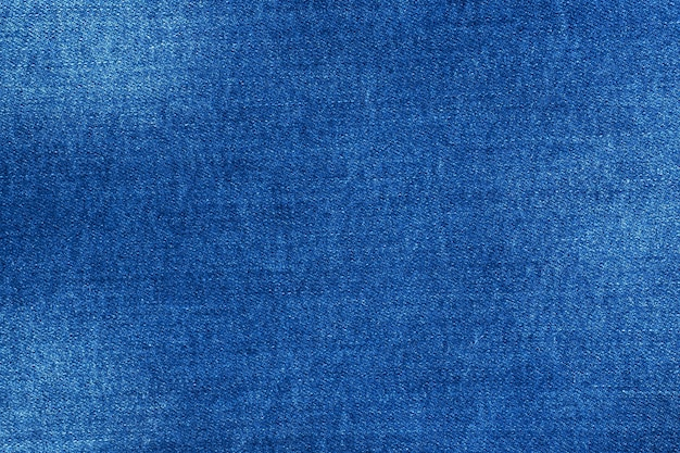 Texture blue denim with scuffs, table material of jeans. Premium Photo