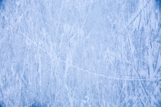 Texture of blue ice surface with skate scratches Premium Photo
