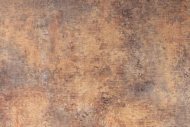 The texture of the concrete wall is covered with brown coating and cracks background Premium Photo