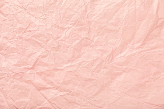 Texture of crumpled pink wrapping paper Premium Photo