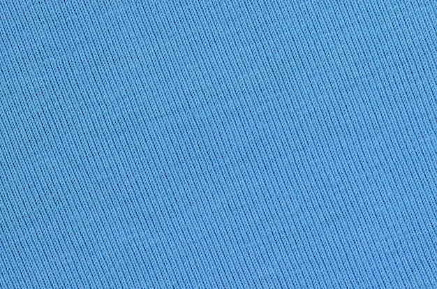 The texture of the fabric in blue background Premium Photo