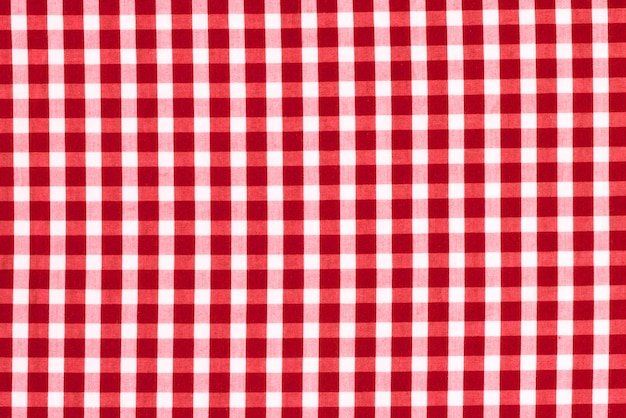 Texture of fabric in a cage. red and white checked fabric. Premium Photo