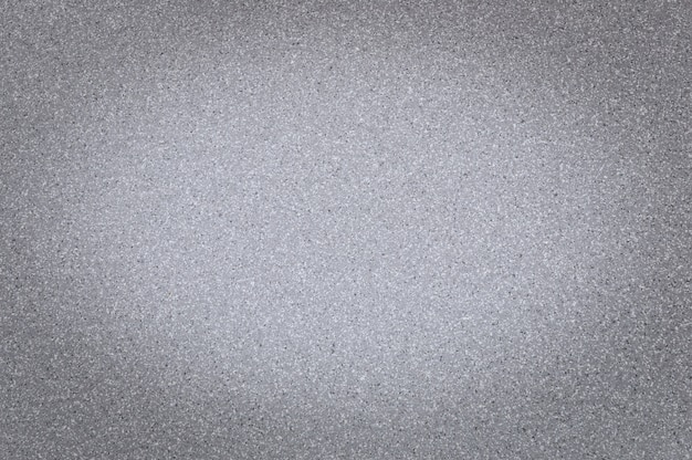 Texture of granite gray color with small dots, with vignetting Premium Photo