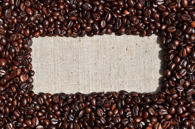 Texture of a gray canvas made of old and coarse burlap with coff Premium Photo