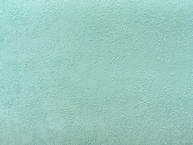 Texture of green wallpaper with a pattern Premium Photo