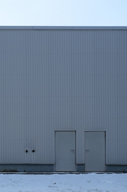 Texture of a high metal wall of an industrial building without windows Premium Photo