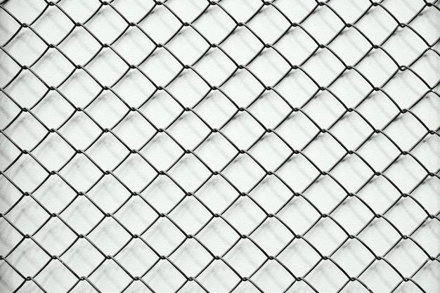Texture mesh chain-link in a row, white background Premium Photo