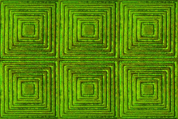 The texture of the metal surface with a pattern in the form of squares and rhombuses in green. Premium Photo