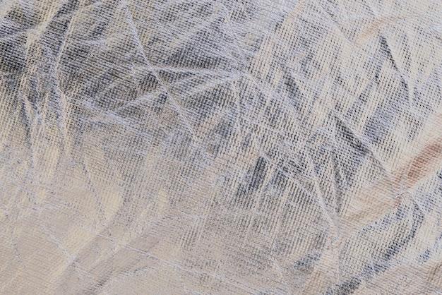Texture of a metallic wrinkled plastic fabric background Premium Photo