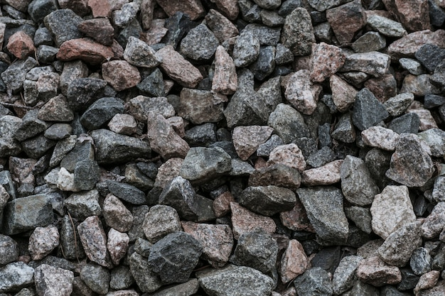 Texture of natural crushed stone on oad Premium Photo