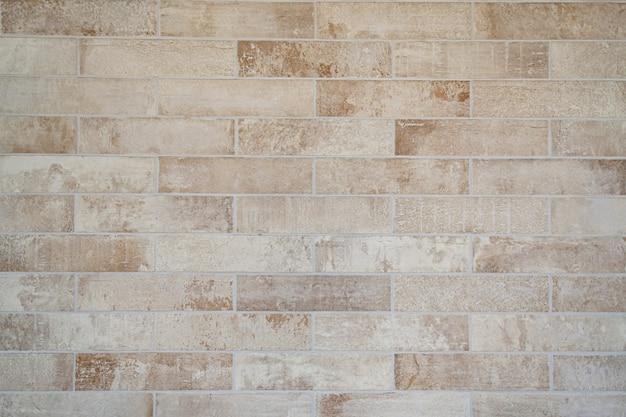 クリーム古いグランジレンガの壁のテクスチャ 無料写真