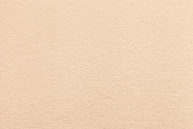 Текстура старой светлой бежевой бумажной предпосылки. Premium Фотографии