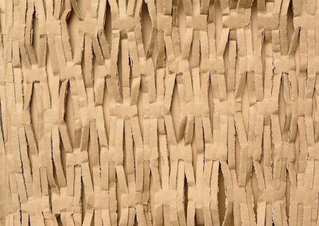 Текстура нарезанных полосок коричневой крафт-бумаги Premium Фотографии