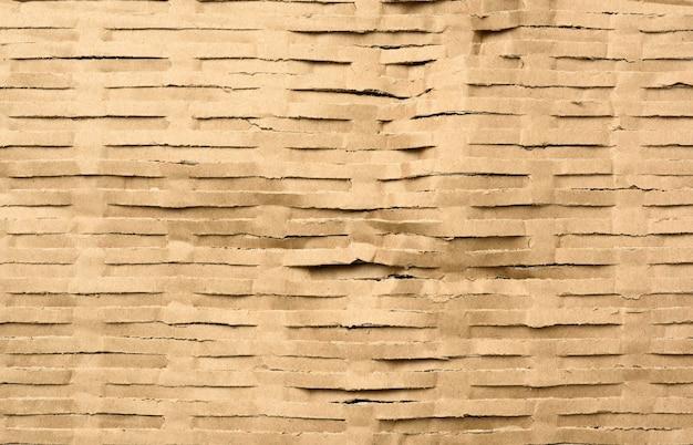 Текстура нарезанной коричневой крафт-бумаги Premium Фотографии