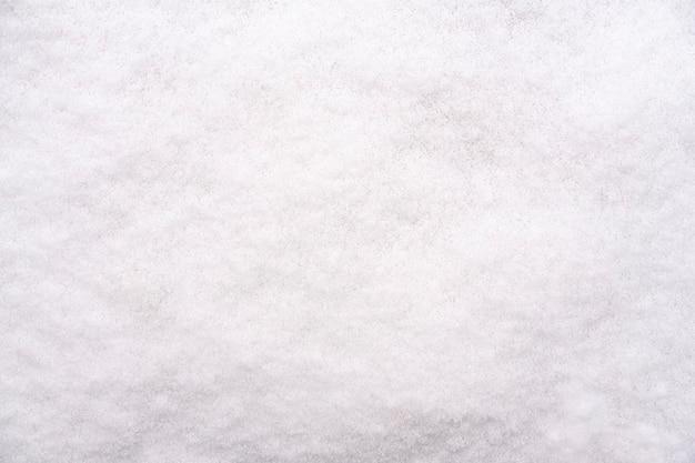 白い新雪の質感。冬の背景 Premium写真