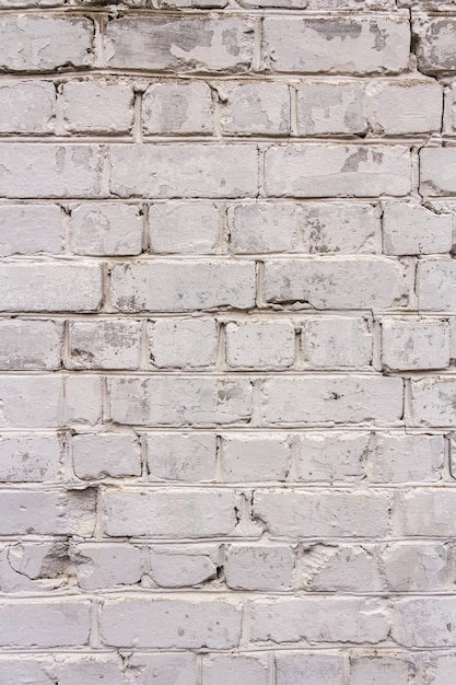 The texture of the old brick. vertical photo. space for text Premium Photo